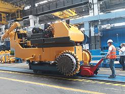 Super Power Pusher moving heavy machinery at Dressta